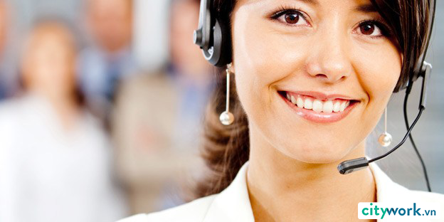 smiling-female-asian-call-center-agent-with-customer-service-team